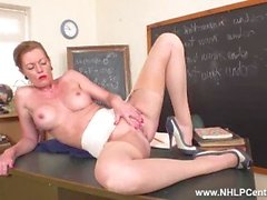 Spunk over Miss Holly Kiss on the desk in mini open girdle vintage nylons