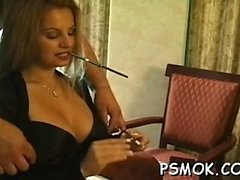 Sexy slut in fishnet stockings teases whilst smoking
