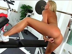 Blonde goddess with big boobs Silvia Saint pleases herself in the gym