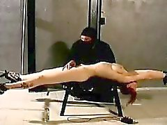 Big boobs redhead gets submitted in cruel bondage scene