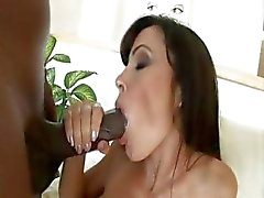 Luscious Lisa Ann's massive tits bounce as she rodeos a hot black cock shaft