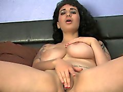 Chubby tattooed and busty babe masturbates