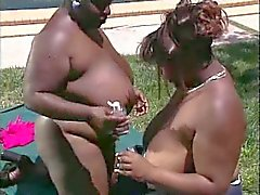 Black BBWs outdoors having sex on a blanket