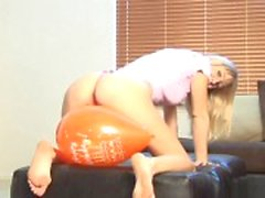Tight body hottie sits on balloon to pop it