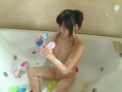 Japanese girl playing in a bath