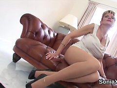 Unfaithful english milf lady sonia flashes her massive boobs